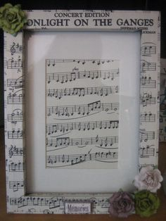 Decoupaged frame with sheet music