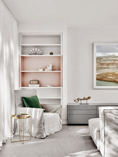 a peek inside an australian home | white walls, pale grey case goods, gold side table.
