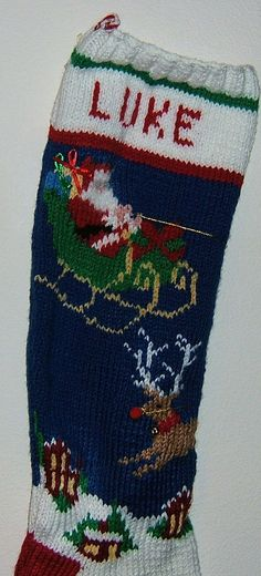 I CANNOT BE SURE OF DELIVERY BEFORE CHRISTMAS 2016! Use coupon code NEXTYEAR for a 15% discount for stockings to be delivered in 2017. Santa and flying reindeer soar across this stocking. A name can be added to each stocking. Just specify the name when ordering. Hand knitted Christmas stockings add a flavor of tradition to your familys holiday.