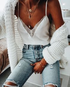 High waisted distressed denim styled with a chunky white cardigan and lace camisole