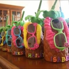Luau party gift- pineapple cups filled with candy, leis, and shades- I used alphabet letters with sticky backs used for scrapbooking to write each kids name on a cup.