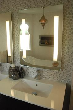 Moroccan bathroom with bio-fuel fireplace over tub.