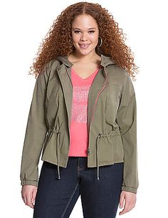 Lightweight anorak jacket is the perfect layer for those fickle-weather days.  Fit to flatter with a drawstring waist, banded cuffs and a hood, this look was made for casual comfort. Zip-front closure with snapping placket. Zippered pockets complete the look. lanebryant.com