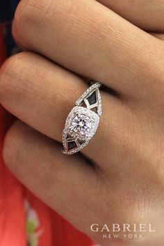 Gabriel - Bold and fearless 14k white gold round 3 stones halo engagement ring with over a carat full of diamonds on the setting. Find more sapphire engagement rings !