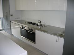 Stainless Steel Bench with Sink -A cleaners Paradise. Best Picture For DIY Laundry cabinets For Your Taste You are looking for something, and it is going to tell you exactly what you are looking for, Laundry Hanger, Laundry Storage, Kitchen Redo, Kitchen Design, Kitchen Ideas, Laundry Stain Remover, Laundry Pods, Reception Desk Design, Laundry Pedestal
