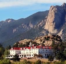 The Stanley Hotel, Estes Park, Colorado.  Also know as The Overlook Hotel in The Shining.... I want to drive that road up to the hotel and stay there a day or two.... in summer, though, not winter! The views of the Rockie Mountains behind that hotel are magical!