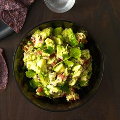 Chunky Guacamole | Mexico City native Richard Sandoval makes his guacamole tableside in a volcanic-rock molcajete (mortar and pestle) and serves it with hot, superthin corn tortilla chips and two kinds of salsa: avocado-and-tomatillo and fresh tomato.