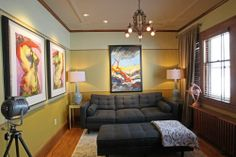 A room used as a TV viewing room in Milwaukee while affording a view of the home's yard.