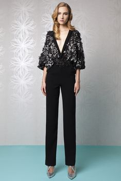 Black Silk Crepe jumpsuit with a deep V-neckline top embellished with Tulle embroideries and poet sleeves.