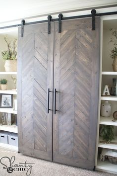 Build a DIY Sliding Barn Door Console to hide your TV and add tons of storage that is perfect for any room. Free plans and tutorial at www.shanty-2-chic.com
