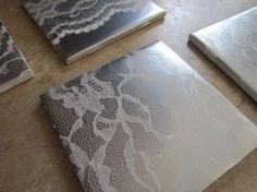DIY Lace Tiles - give plain old ceramic tiles a pretty lace motif using spray paint and lace scraps.