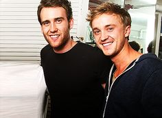 Neville Longbottom and Draco Malfoy. extra points to both houses!