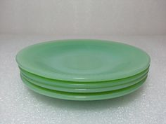 Set of 4 Fire King Jane Ray Jadeite Saucers. $18.49, via Etsy.