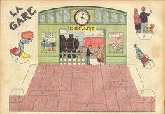 cette fois, c'est une gare, avec ses guichets, ses voyageurs, ses employés...