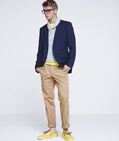 This is a great look. Preppy, fun, casual, light. The yellow shoes and yellow shirt really make the outfit a whole, as opposed to separate pieces. The rolled up khakis are great for late summer, the jacket can bring it into the fall. The grey sweater really helps bring the casual element into this little number.