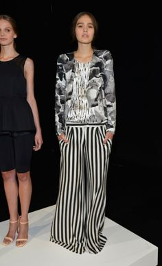 From the 2012 Mercedes-Benz Fashion Week : KAELEN    What's Black, White & Red all over?  A sloppy lush who poured Bordeaux all over themselves, while wearing this ensemble.