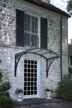 Gutierrez Studios  Installations  Joppa Canopy & wrought iron canopy over window - Google Search | wrought iron ...