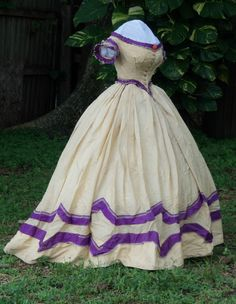 Colorful barege ballgown c.1863 It always amazes me when I see a civil war era dress such as this one. So often the trims and color choices were un-delicate and even geometric.