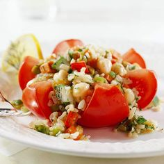 A mixture of diced vegetables and fruit fills pretty tomato flowers -- an ideal side dish for a casual garden party: http://www.bhg.com/recipes/salads/our-best-tomato-salad-recipes/?socsrc=bhgpin032014stuffedtomatoflowers&page=13