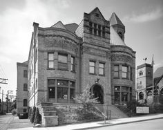 """First Carnegie library: the Braddock Carnegie Library, Braddock, Pennsylvania, 2011. """"The once glorious but now faded interior included a gym, a theater, and a swimming pool, as well as book collections and reading rooms."""" Photographed by Robert Dawson."""