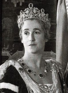Marchioness Sybil Cholmondeley, nee Sassoon, wearing her impressive belle epoque sapphire tiara, part of a larger parure. Designed as seven large sapphires, atop a significant diamond foliate tiara. This photo was taken just prior to the Coronation of Elizabeth II in 1953.