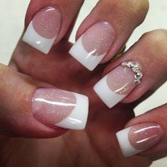 Dreamy looking French manicure adorned with glitters. The manicure starts off with a clear nail polish as base and tipped with thick and shapely white polish. A wonderful array of glitters is also sprinkled on top for a more dreamlike effect.