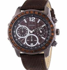 Guess Brown Leather Strap Chronograph Watch W0017L4 Guess Lady B Ladies Wrist Wear. Brown Chronograph Dial. Polished Ion Plated Bronze Stainless Steel Case with Baguette Style Stones on Bezel. Brown Imitation Lizard Look L (Barcode EAN = 0091661417726) http://www.comparestoreprices.co.uk/ladies-watches/guess-brown-leather-strap-chronograph-watch-w0017l4.asp