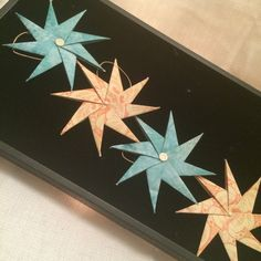 Set of 4 origami star ornaments