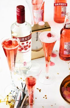 Pop the cork and pour a round of these sparkling Smirnoff Raspberry cocktails. Serve them in a cute flute on New Year's Eve for a glittery drink that will make everybody's eyes sparkle in 2017. Happy NYE!    Here's an easy and delicious recipe to ring in the New Year with 8 friends: 1 CUP SMIRNOFF RASPBERRY 1 BOTTLE CHAMPAGNE  3 CUPS POMEGRANATE OR CRANBERRY JUICE SERVES 8