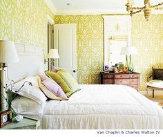 Bedroom with citron color patterned wallpaper