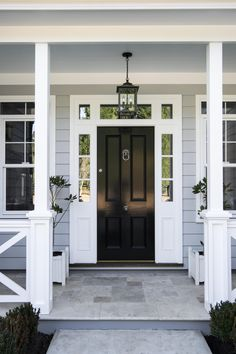 41 Unique And Elegant Door Decoration Ideas - As homeowners we enjoy to show off our beautiful homes and decoration skills. All of us are not that creative when it comes to entrance ways but we al. White Exterior Houses, Grey Exterior, House Paint Exterior, Exterior House Colors, Bungalow Exterior, Exterior Design, Light Blue Houses, Grey Houses, Black Front Doors
