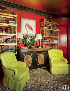 A flamingo print hangs above a cabinet in the library of a San Francisco home designed by Thomas Britt