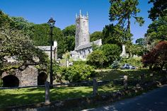 The beautiful village of Altarnun in Cornwall, England with the 15th century church of St Nonna, the Celtic Cross that stands by the church gate dates back to the 6th century