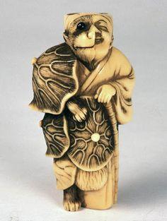 Tanuki transforming to priest: (Kyoto school), ivory.