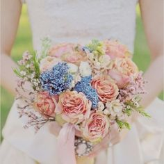 Peach with an unexpected pop of blue bouquet