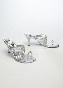 "Sizzle in this sassy cascading sandal!  Perfect for summer, these unique sandals offer glamour and glitz from the ballroom to the beach.  3"" Heel. Available in Silver.  Available in select stores and online."