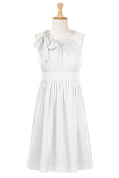 Possibility! Simple, white, cotton. Can add a petticoat and make it swirly.