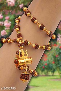 Pendants & Lockets Stylish Shiv Trishul Damaru Rudraksha Mala Rare collection for unisex pack of 1 Base Metal: Brass & Copper Plating: Gold Plated Stone Type: Rudrakshi Type: Pendant with Chain Multipack: 1 Sizes: Country of Origin: India Sizes Available: Free Size   Catalog Rating: ★4.3 (435)  Catalog Name: Elite Chunky Pendants & Lockets CatalogID_1327558 C77-SC1095 Code: 351-8035495-998