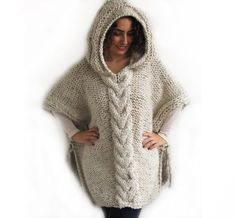 This poncho is hand knit with cable knit pattern. It is made with alpaca yarn. It has a hood. You can wear it on your tops or on coats. Its very warm and cozy. I can also make this capalet in any colour and your measures.  It is voluminous. Over size - Plus size.   For to see our shop: http://www.etsy.com/shop/afra  Any question, just convo.   -----------------Made in a pet-free and smoke-free environment.-----------------  -----------------All hand crocheted and hand knit...