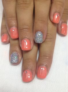 Very cool orange/coral summer nails!! Pigment powder added to non-toxic odorless gel with halo glitter/gel accent nail and rhinestones to complete this great funky look!!