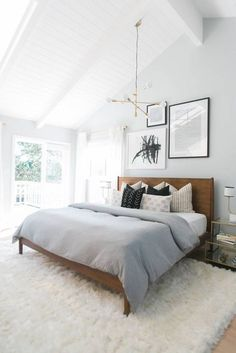 The rug in this domino.com image really makes this bedroom fit together! Love the white features! To find out more check out naomifindlay.com