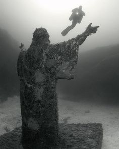 """Thirteen-ton underwater statue-art of the Lord Jesus Christ. Created by artist Alfred Camilleri Cauchi and located on the Meditteranean sea floor in Malta.  """"Come, follow me,"""" Jesus said, """"and I will send you out to fish for people."""" -Matthew 4:19 Photograph by ©Anatoly Beloshchin via www.anatoly.pro #AbandonedEarth"""