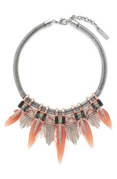 The eclectic mix of colorful spikes, sparkly crystals and contrasting metals of this statement necklace would look so fab with a LBD.