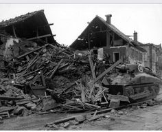 An American Sherman tank crew attempts to use this destroyed building as cover.