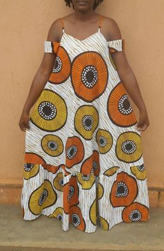Stand out from the crowd in this long flowing African print maxi dress with its unique colorful prints. Made in cotton Ankara and A line in shape for your comfort. Fits bust size 34 inches to 38 inches (US size 6 to For custom orders please send African Maxi Dresses, Latest African Fashion Dresses, African Print Fashion, African Attire, Ankara Fashion, Africa Fashion, African Prints, Moda Afro, A Boutique