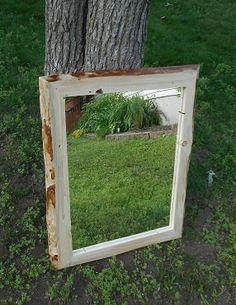 This Spruce framed mirror has a natural edge that gives a rich contrasting color to the face of the frame.   This could easily be used as a wall-hung mirror or as a mirror that rest on top of a mantle and leaning against a wall. This frame is rustic in nature meaning that there may be imperfections in the wood such as cracks or wormholes that give the frame that natural, rustic look but do not negatively impact the integrity of the frame in any way.