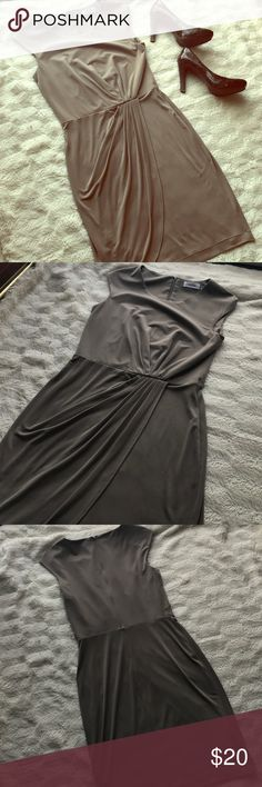 Gorgeous Calvin Klein dress Taupe colored CK dress with flattering draping. Comes just to the knee. Comes with original belt. Fabric is 95% polyester and 5% spandex. EUC. Calvin Klein Dresses Midi