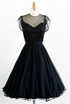 1950s cocktail party dress made of black silk satin and elaborate floral lace…