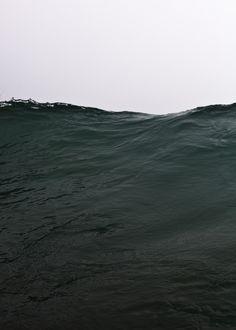 dark turquoise water Photography by Reza Bassiri.