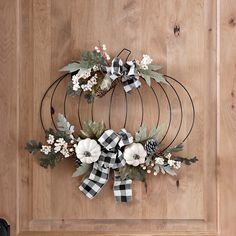This Metal Pumpkin and Buffalo Check Bow Wall Hanger is perfect for fall. The greenery and cream pumpkins are a nice change from traditional orange fall decor. Dollar Tree Pumpkins, Dollar Tree Fall, Dollar Tree Decor, Dollar Tree Crafts, Metal Pumpkins, Fall Pumpkins, Harvest Decorations, Fall Decorations Diy, Pumpkin Decorations